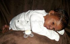 Ethnic reborn doll for adoption
