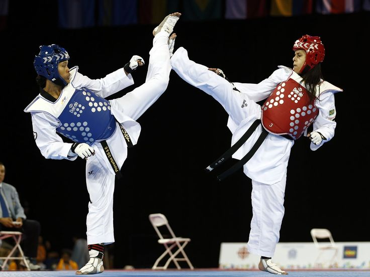 Paige McPherson of the the United States, left, fights Julia Vasconcelos of Brazil in the women's taekwondo 67kg semifinals during the Pan Am Games in Mississauga, Ontario.  Jeffrey Swinger, USA TODAY Sports