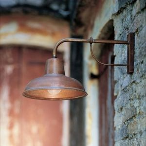 The District Exterior wall light is a statement of classic beauty. Designed and Made in Italy from local materials. The pre-aged finish on the base of this lamp is achieved through the technique of patinating, allowing the designer to apply a thin film to the metal. This design tactic not only enhances the light aesthetically but also offers extra protection from exterior forces.
