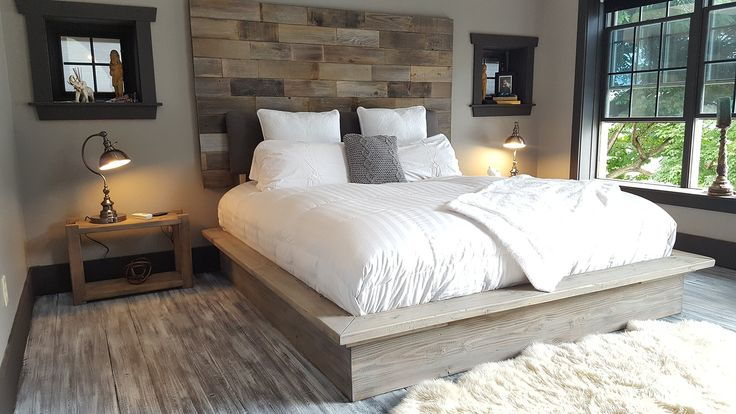 """Grey weathered modern industrial reclaimed recycled wood wall mount headboard art. This rustic modern industrial headboard is handmade using scraps of reclaimed/recycled weathered wood. Sanded and fitted to leave enough raw texture while being soft/smooth enough to lean/prop pillows up against. Finished with a customized wax. Hangs securely on your wall by using a cleat system that is provided. Headboard/ art measures 20"""" tall and each bed size will determine the width, depth is 1.5"""" If…"""