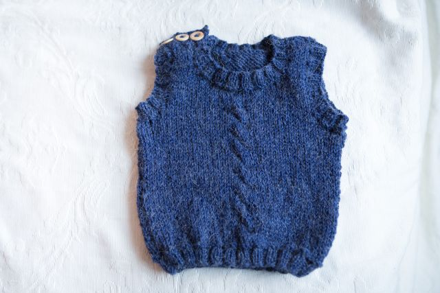 Knitted blue baby vest