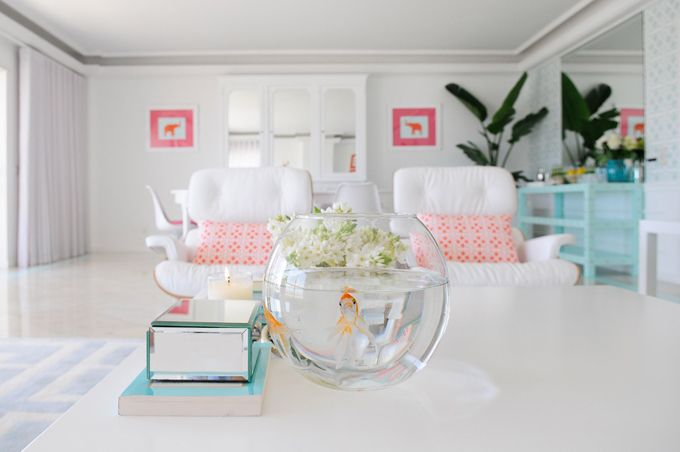 House of Turquoise - all white space spruced up with aqua, orange and pink and great patterns