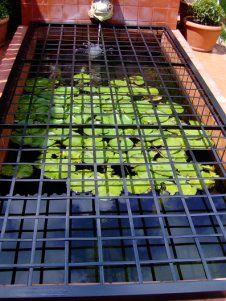 Custom safety grid for a pond