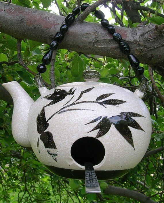 Teapot birdhouse.  I've made teapot birdhouses in pottery before, but I put my hole up higher on the pot, so the baby birds won't fall out!