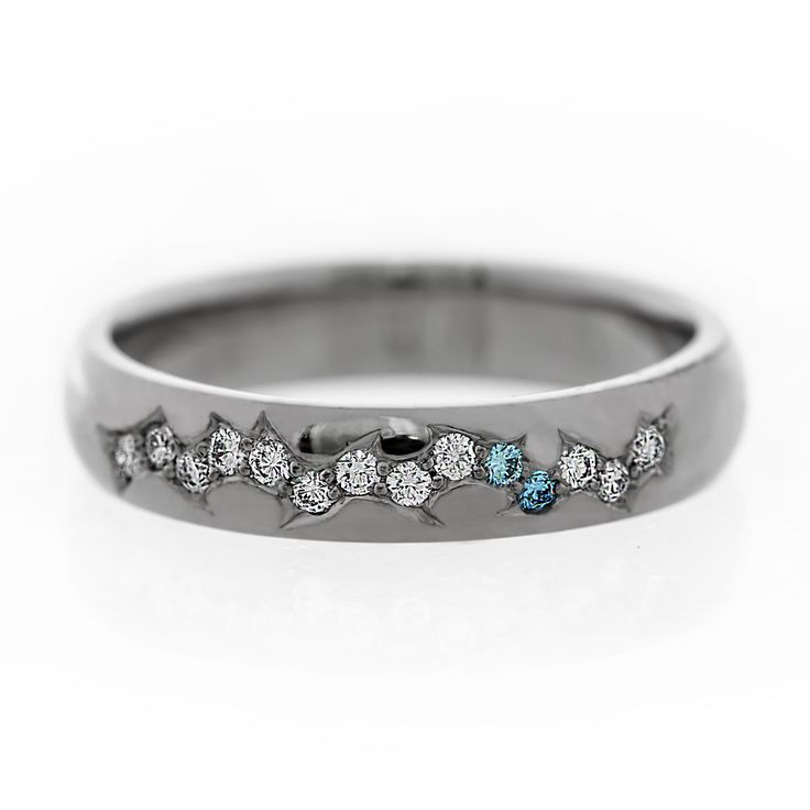 Wedding band with white and blue diamonds