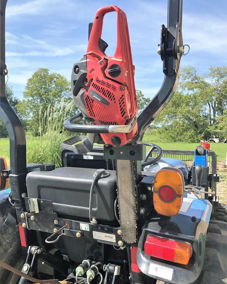 SawHaul in action! www.sawhaul.com. . . . . . . . . . . #tractor #mower #chipper #landscaping #firewood #burnpile #farm #country #invention #life #weekend #sunny #sky #garage #homeimprovement #secure #safe