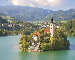 The Church on the idyllic Bled Island in the midst of the Alpine lake is enthralling. One can only reach it across the lake with a pletnja, a unique covered wooden boat. #UrbanSpaces #CitySpaces