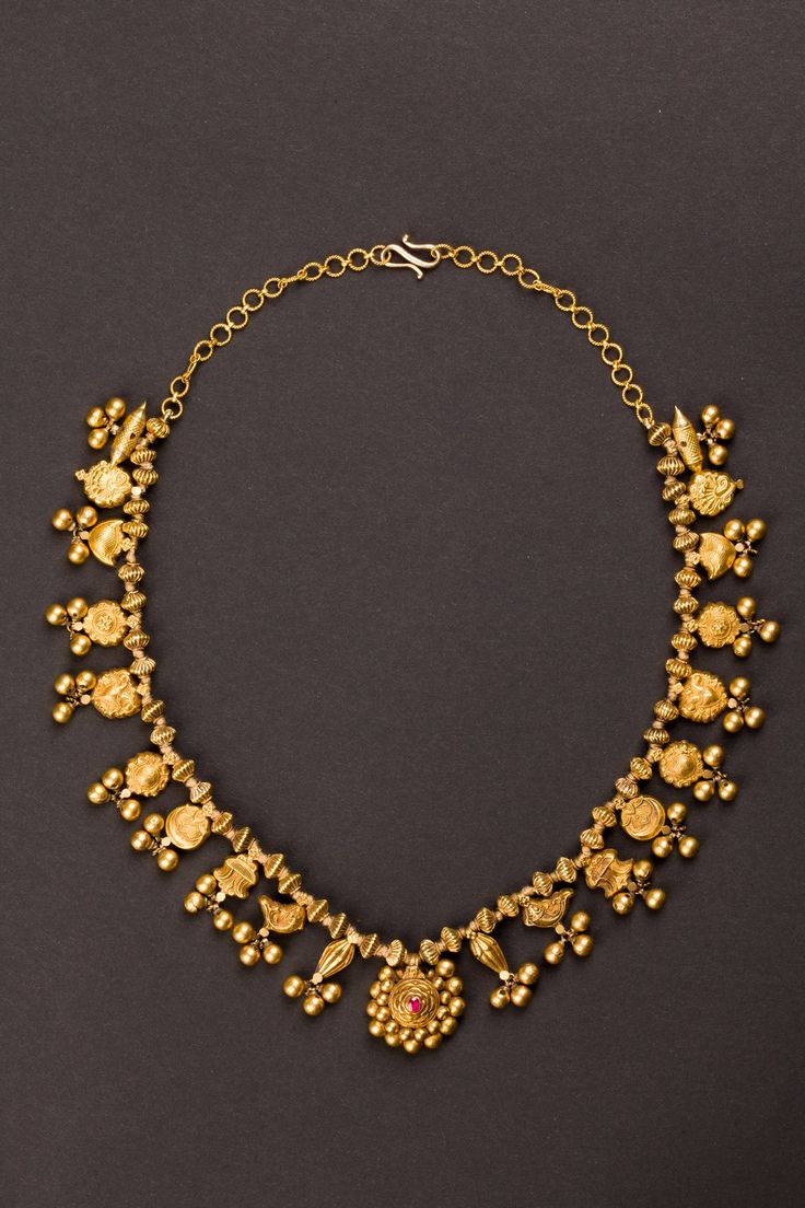 Maharashtrian gold wedding necklace with twenty-nine pendants, each with a different symbolic and propitiatory meaning. Circa 1900s -- 22k gold