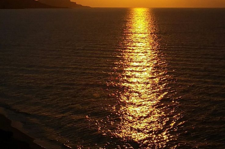 Sunset in blach. Spectacular sunset in Castelsardo, city of the north coast of Sardinia, in Italy.