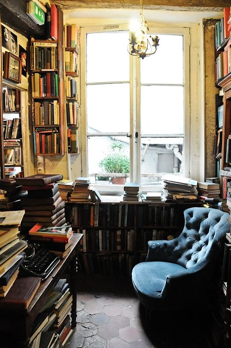 Cozy work space, great windows, nice chair and books, books, books
