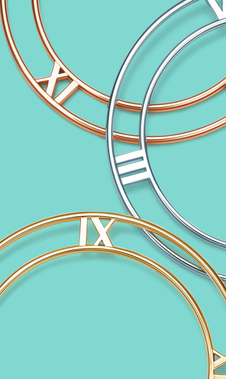 Holiday countdown. In sterling silver and 18k yellow and rose gold, these Atlas® bangles feature striking Roman numerals.