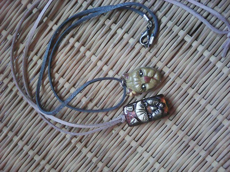 Khajit faced pendants