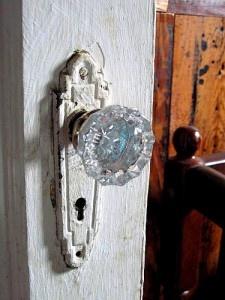 vintage glass door knobs on thick oak doors