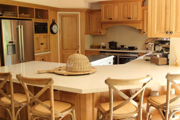 American oak kitchen with oak cross back stools
