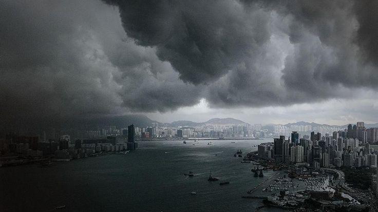 Clouds build up over the Victoria Harbor before a storm in Hong Kong on April 30, 2013. (Philippe Lopez/AFP/Getty Images)