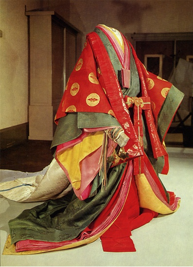 Jyuuni-hitoe (十二単; 12 layered Kimono). The Heian-era noblewoman's fashion, were often robes imported & adapted from China's Tang Dynasty. This is where we can find the origins of Japan's artisan skills beginning to blossom in silk (& eventually other fabric) production, weaving, dying, screening, as well as embroidery. The Imperial family women still wear this style for certain ceremonies & occasions. Although, the more contemporary Kimono is what they'll wear to formal gatherings if dressed…