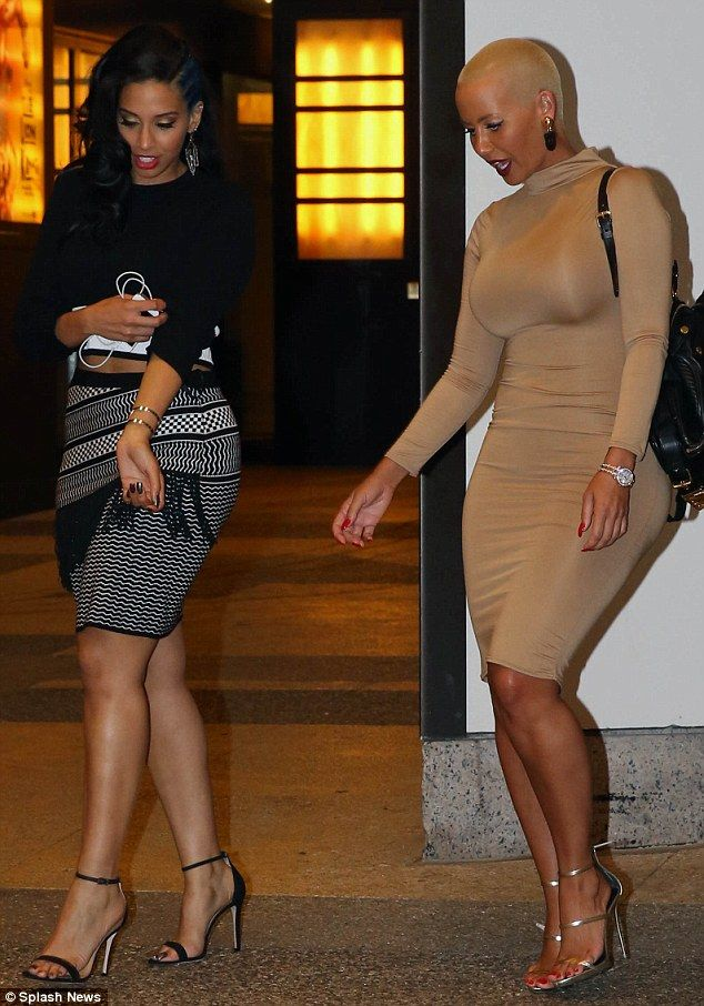 Pins on parade: The mother-of-one and her well-dressed pal flashed their slender legs in their knee-length outfits
