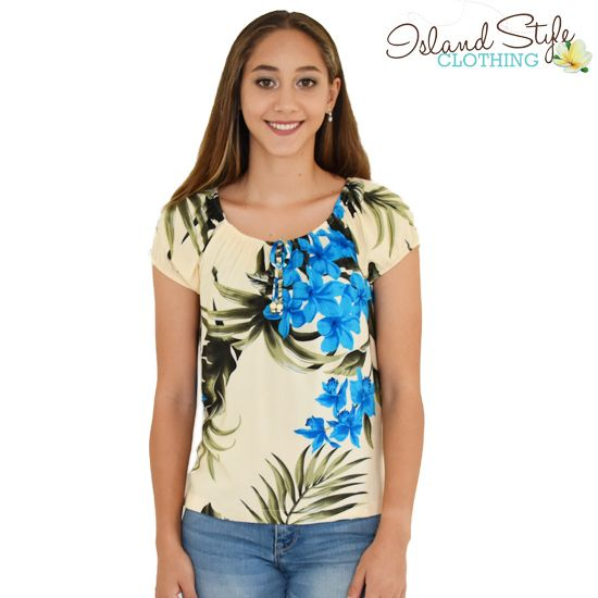 Ladies Hawaiian Blouse - Round neck with cap sleeve. Cream & Blue Leaf pattern. We have exact matching mens hawaiian shirts.