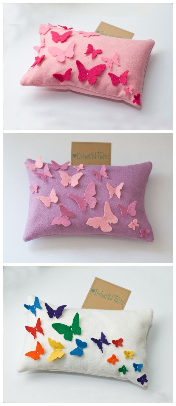 Rainbow felt butterflies on a pillow.these would be great for a little girls room