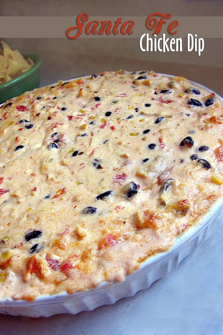 Santa Fe Chicken Dip Yum!!!...Ingredients: 2 medium boneless skinless chicken breasts (shredded) 1 (10 ounce) can of Ro*tel Original 1 cup mayonnaise 1 large chipotle pepper (packed in adobo) 2 (8 ounce) blocks of cream cheese 1 (15 ounce) can of black beans 3/4 cup sweet corn 8 ounces Cabot Vermont Sharp Cheddar Cheese (shredded)
