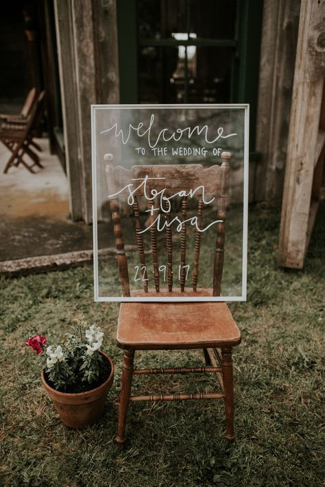hand lettered wedding welcome board on re-purposed picture frame