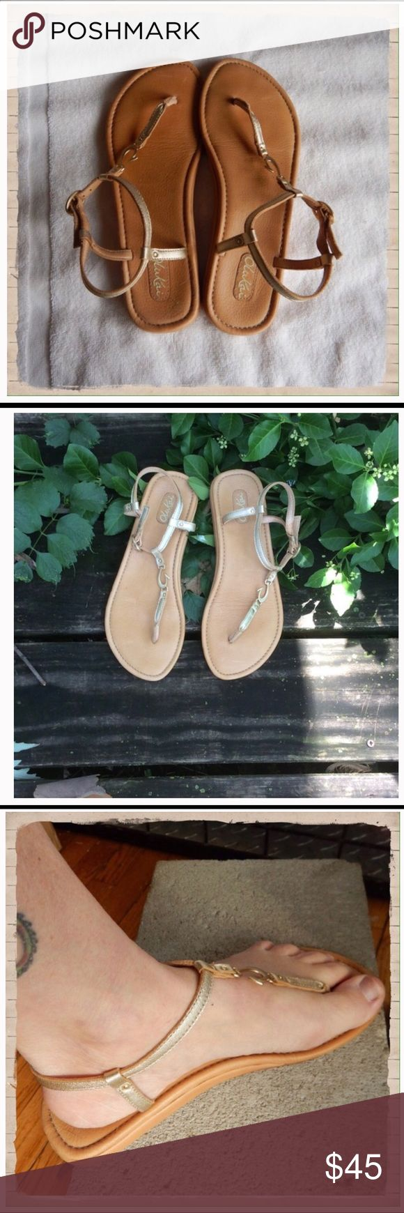 OluKai Gold Leather Sandals Worn once, these beautiful sandals have the OluKai trademark Hawaiian fishhook in gold metal in the center strap. Cushioned leather insole, leather sole with rubber at the heel for better traction. OluKai Shoes Sandals