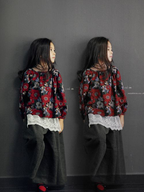 I love the way this outfit looks. I like the red flowers on the shirt :)