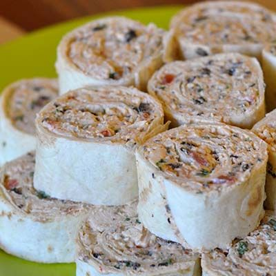 Creamy Chicken Enchilada Rollups—Great party appetizer! Easy to make ahead of time and travels great!