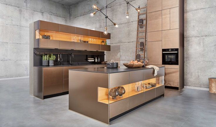 Our metal kitchen fronts: the surfaces of the Metal-L line offer five different colour options and two structure options through the combination of a hand-filled base surface and an industrial metallic top lacquer.  This kitchen showcases a zeyko longboard with cherry veneer as a design element. The warm wood tone complements the modern metal look to give a warm and homely overall appearance.