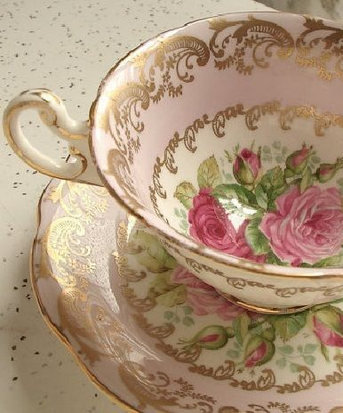 Teacup in pink and green.