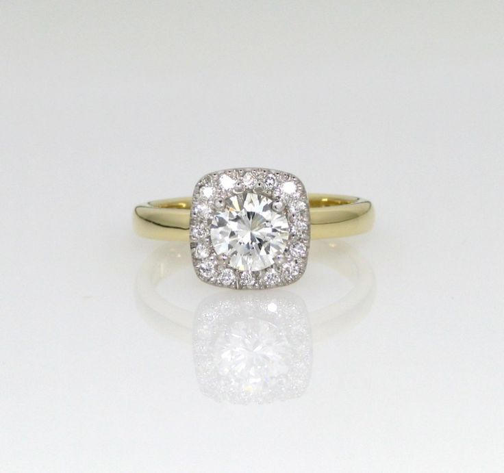 18kt white and yellow gold diamond halo ring set with a 0.90 ct F VS2 as the center stone