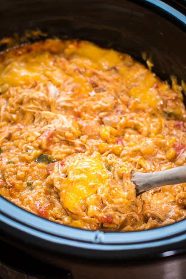 Slow Cooker Fiesta Chicken and Rice Casserole from themagicalslowcooker.com | This is a super simple dish to make whether your are a beginner or seasoned cook. Using a boxed Spanish rice mix is a handy shortcut, but feel free to make your own Spanish rice recipe to add to this dish. | tch.