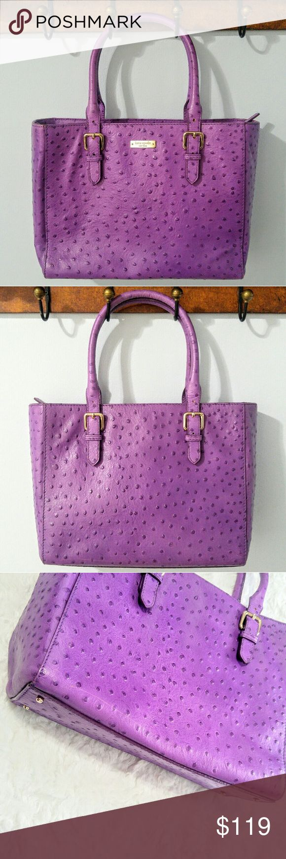 "Kate Spade Purple Ostrich Embossed Tote Beautiful purple authentic Kate Spade ostrich embossed leather handbag. Beautiful and unique hard to find/rare color! Height 9.5"", width 3.5"" (at bottom), length 12"" (at bottom), drop length 6.5"".  Minor flaws: a few scratches on back, & bottom, including a long thin scratch almost all the way across bottom back side, slight corner wear, tiny faint makeup specks inside on liner, one crack on handle and small spots of wear on handle. Small pen mark at…"