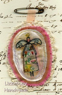 stitchery brooch using Terrye French stamps