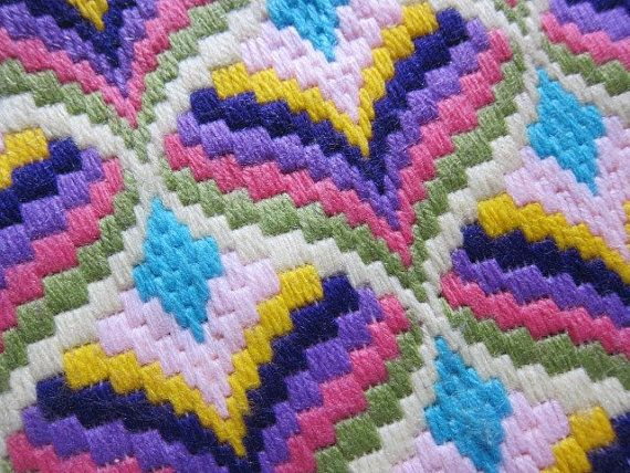 A bright piece of Florentine bargello needle work from the 1960s or 70s. fabulous colors of light sage, rose pink, deep lilac, purple, yellow, shell pink and turquoise. Hand stitched on canvas in vibrant wool. Good vintage condition, neatly worked, just a few stitches to be completed on the edge. Ready to be turned into a vibrant pillow, tote or whatever a clever crafts person can dream of. Measures 18,5 (47cm) x 16 (42cm)