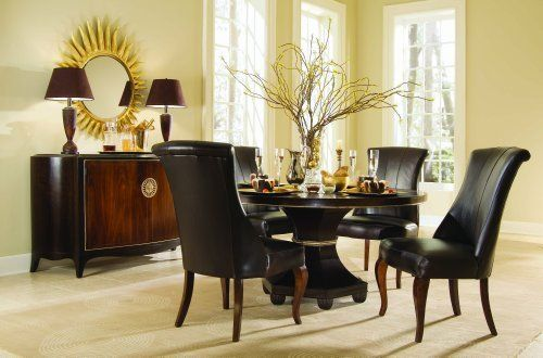 Bob Mackie Home-Signature Dining Table - American Drew 591-701R by American Drew. $2100.00. The Bob MackieHome-Signature Dining Table includes round table top, and table base. Transform your dining area with thisRound Dining Table with featherdetail in the table top grain. Brass outlines the table's edge and accents its pedestal base. Carved ball-shaped feet support the table adding another refining touch tothis classic piece. Thistable is usually in stock and ...