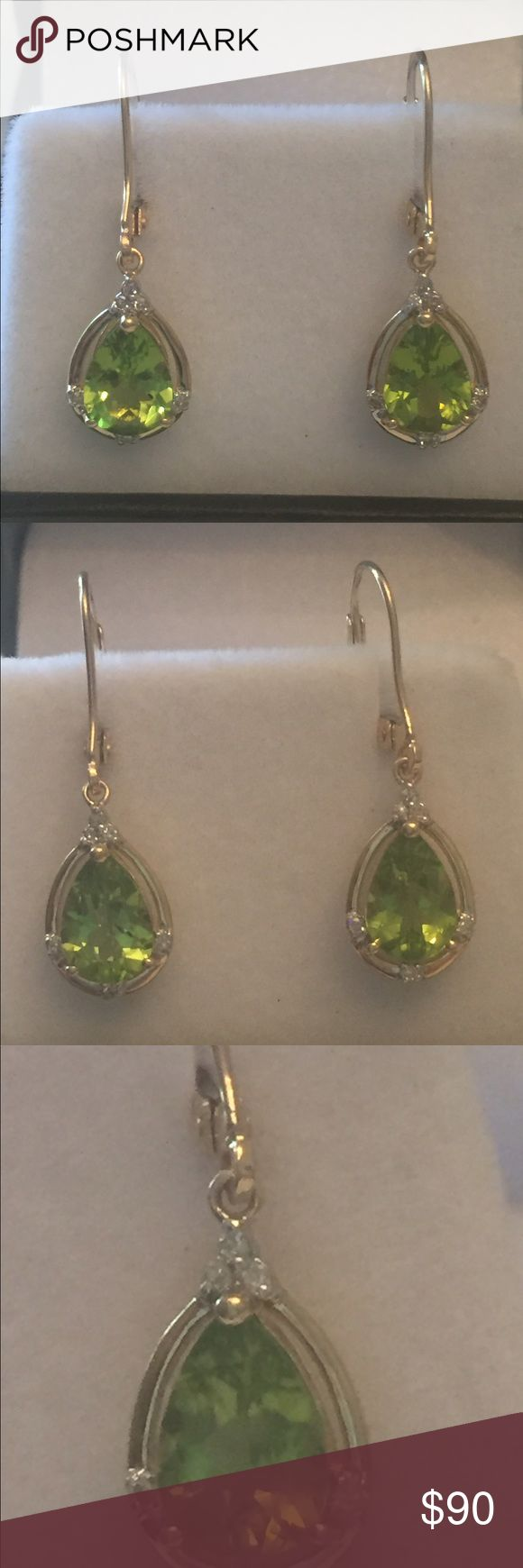 Peridot and diamond earrings  in 14 kt yellow gold Brand new 2 Ct pear shaped peridot (1 carat each earring) and diamond earrings ( 6 diamonds in each earring) set in 14 kt yellow gold. Peridots are AAAA quality which is the best. Their color is bright with no inclusions. The diamonds are approximately I- J color. There's a 14 kt stamp which can be seen in the photos. Jewelry Earrings