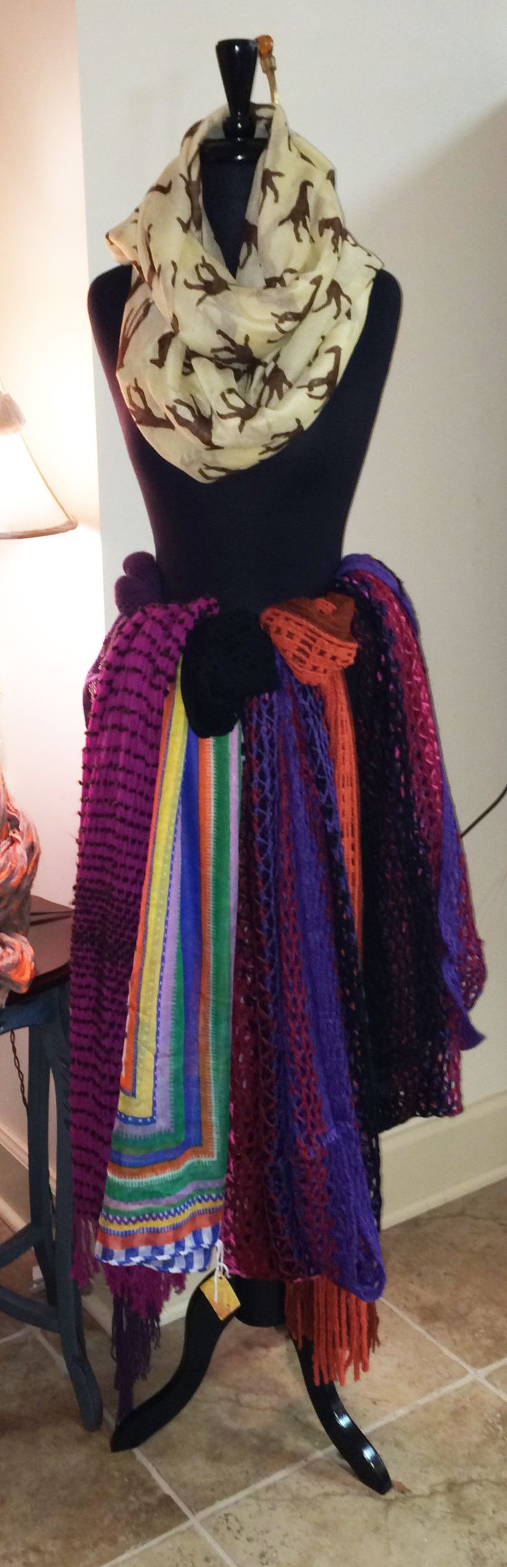 Fun way to display scarves! One around the neck and the rest as a skirt, secure over the belt