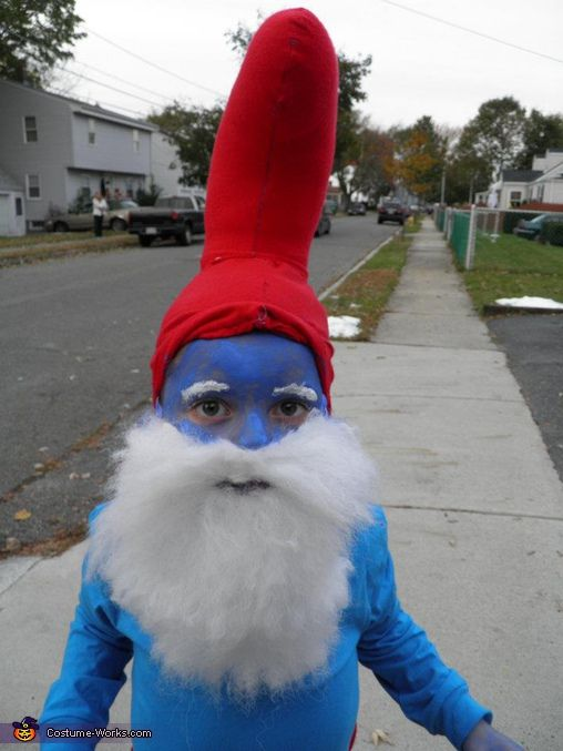 """A word from Justine, the 'Papa Smurf' costume creator: """"My 6 year old son is wearing the Papa Smurf costume. We thought that the costume being sold was cheesy and cheap looking. My father hand sewed hat and belly insert to make him fat and sewed on beard and painted him blue."""" (site shows adult & child costume)"""
