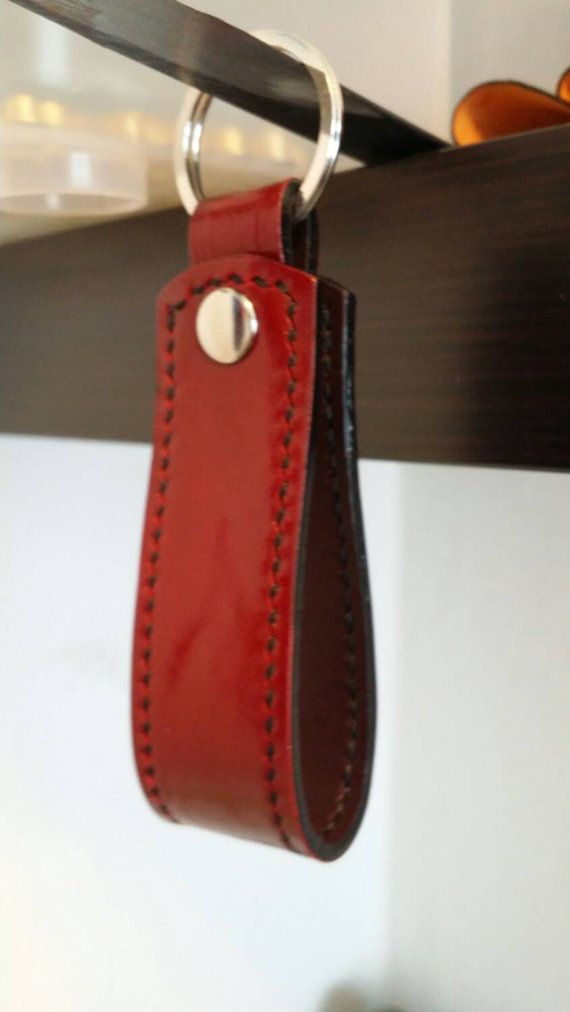 Check out this item in my Etsy shop https://www.etsy.com/nl/listing/241193444/red-leather-belt-keychain-keyfob