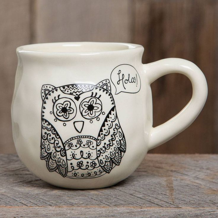 """Owl Happy Mug - With a handcrafted feel and generous 16-ounce size, this """"happy"""" ceramic mug features an owl saying """"hola!"""" and a heart printed on the inside bottom. Perfect for gifting. Dishwasher and microwave safe.ALL SALE ITEMS ARE FINAL SALE. Please refer to our Return Policy for more information."""