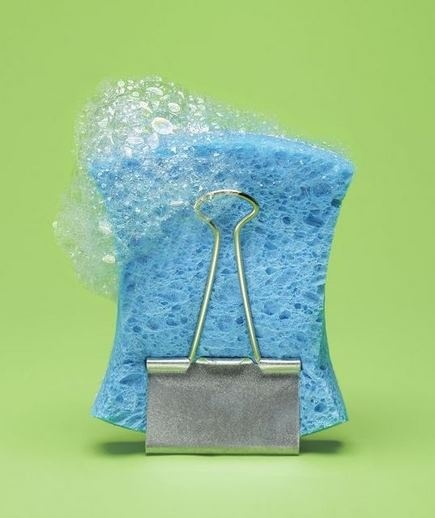 To prevent a smelly, waterlogged sponge, air-dry it in a binder clip away from the sink.