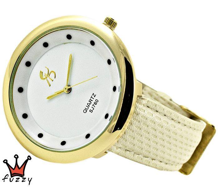 Γυναικείο ρολόι, σε χρυσό και εκρού, με κομψή και λιτή γραμμή σχεδιασμού. Λουράκι δερματίνης σε εκρού χρώμα. Διάμετρος καντράν 44 mm.
