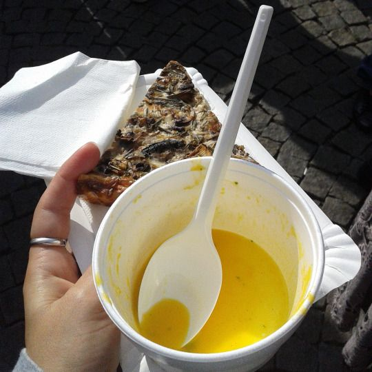 Pumpkin soup with mango and mint oil and a mushroom quiche at a food festival in Prague, Czech Republic