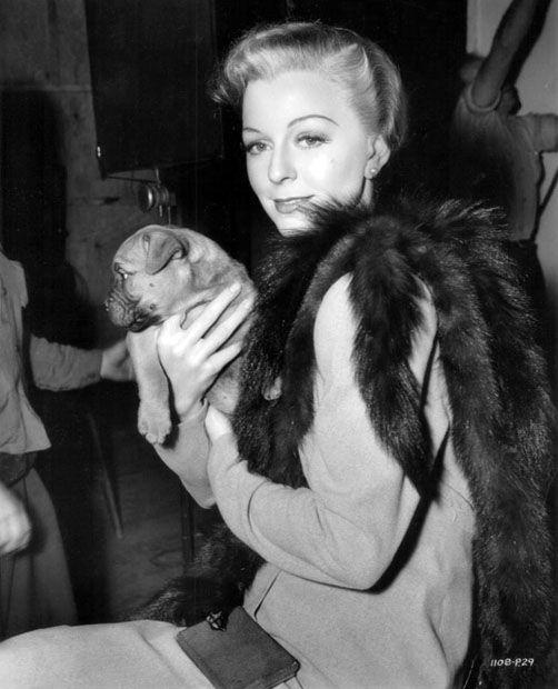 Margaret Sullavan with the puppy Back Street cinematographer William Daniels gave her
