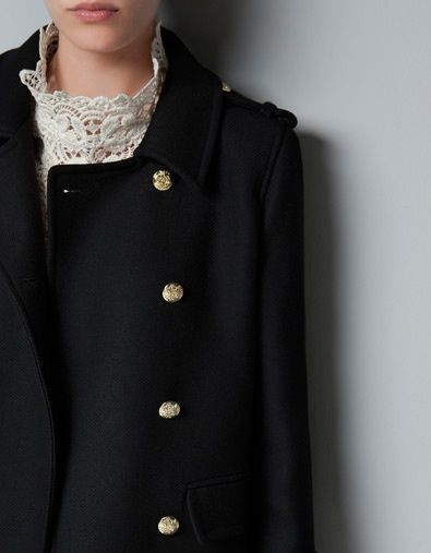 military style coat paired with feminine lace