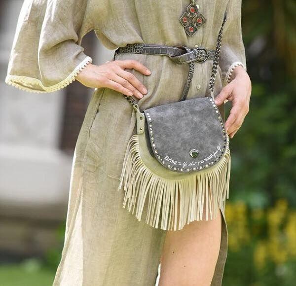Blogger Chrysanthi Kosmatou strolls around London, during London's Men Fashion Week, in an a #LePandorine crossbody fringe bag