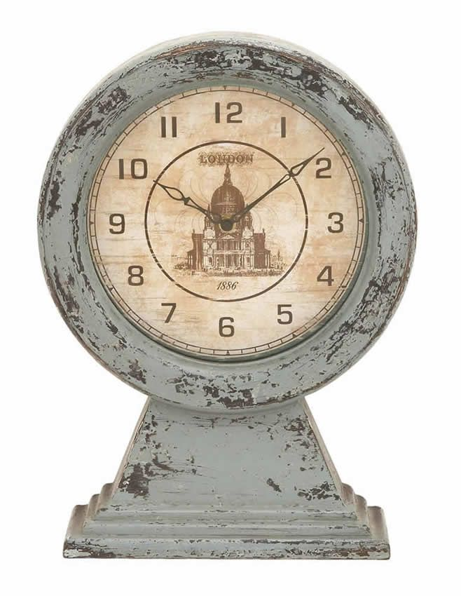 Antique Vintage London Themed Table Top Clock Distressed Uma 69257  The ultimate time piece as well as the ultimate piece of decor for any contemporary or vintage styled home. The clock face is perfectly circular with classic 19th century London building decorating the center. Made with aged gray wood that resembles, this table top clock will enjoy a long life of timekeeping on the end table or on the fireplace mantle.