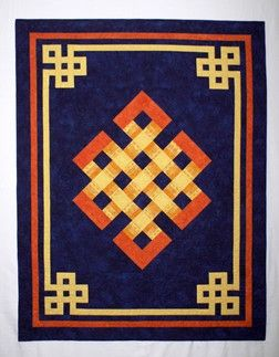 The ölzii, or never-ending knot, is a traditional Mongolian motif symbolizing the dynamic expanse of the universe and the endless cycles of life and death. It brings long life and prosperity, and drives away wild beasts and evil spirits. This symbol is used widely in Mongolia as decorative art and the pattern for the quilt, including the border, was taken from the door of a Mongolian ger (yurt). You may use either a dark ... pattern here…