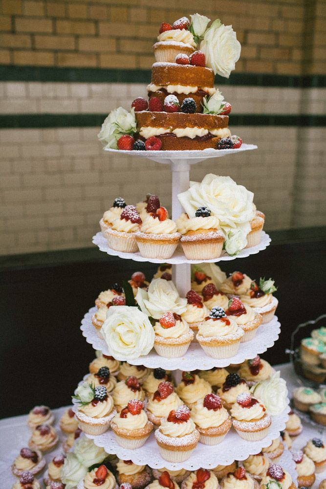 Something a little like this but with a rustic wood cake tier & sunflowers instead...